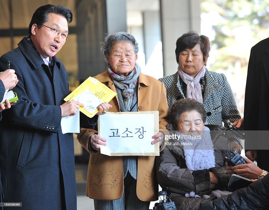 Two South Korean women (2nd L and lower R) forced into sexual slavery by Japan during Tokyo's 1910-45 occupation of the country enter a Seoul prosecutors' office on March 4, 2013, along with a lawyer and other activists to file a defamation suit against a Japanese rock band that called the women 'prostitutes' in a song. A group of South Korean women forced into wartime sexual slavery by Japan filed a defamation suit nday against a little known Japanese rock band for calling them prostitutes. A CD containing a song with the allegedly defamatory lyrics by the band 'Scramble' was mailed -- along with a translated text -- to a shelter caring for so-called 'comfort women' in Gwangju, south of Seoul, last week.