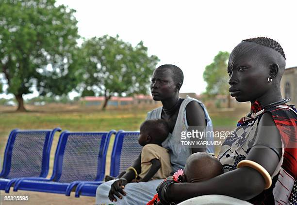 Two south Sudanese women wait for health care at a clinic, on April 2 at Terekeka, 82 km north of Juba, an area where the population is exposed to...