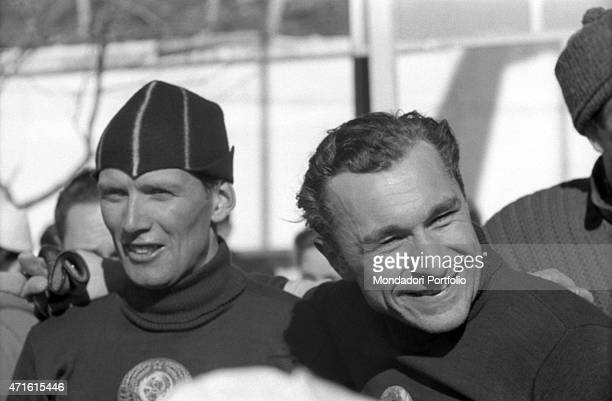 Two Soviet athletes competing in the VII Olympic Winter Games getting ready for a race Cortina d'Ampezzo 1956