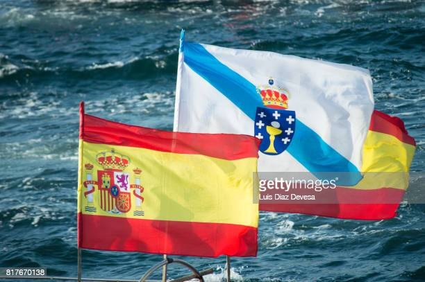 two Spanish flags and in the middle one flag of Galicia