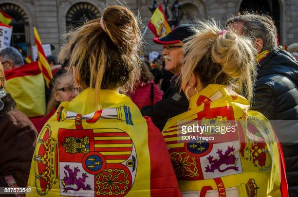 Two Spanish loyalist young girls with their backs covered with Spanish flags Spain celebrates today the 39 anniversary of its Constitution This year...
