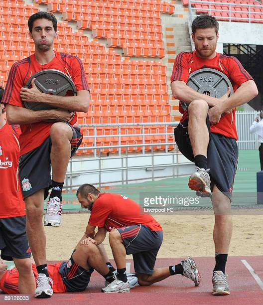 Two Spanish players Alvaro Arbeloa and Xabi Alonso both carry weights during a Liverpool training session on July 21 2009 in Bangkok Thailand