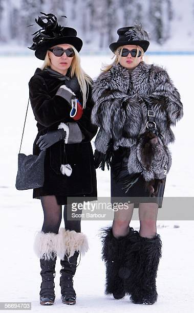 Two specators brave the freezing conditions as they watch a match during the 22nd Cartier Polo World Cup on Snow on January 28 2006 in St Moritz...