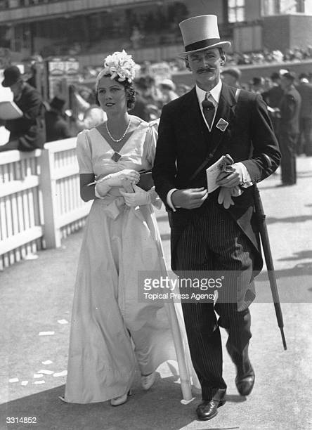 Two spectators in morning dress at Ascot races