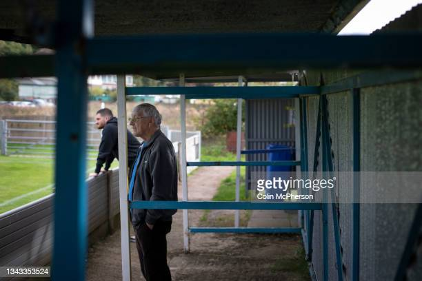 Two spectators watching the first-half action as Runcorn Town play Pilkington in an FA Vase second qualifying round tie at the Viridor Community...