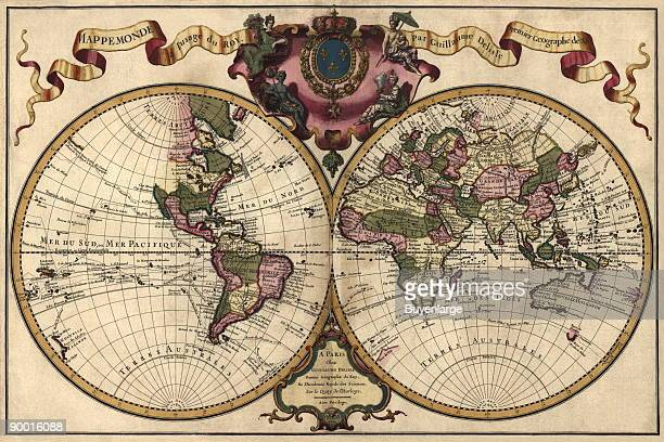 Two Spheres in circles show the worlds hemispheres with Ribbon Flourish