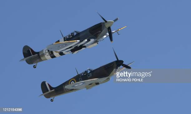 Two Spitfires from the battle of Britain memorial flight fly over the cliffs of Dover southern England on May 6 2020 to commemorate the 75th...