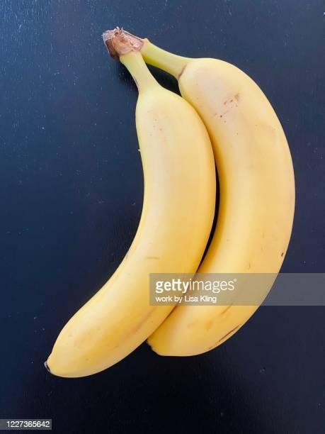 two spooning bananas - abbracciarsi a letto foto e immagini stock