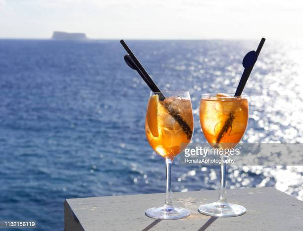 Two Aperol spritz drinks by the sea, Malta