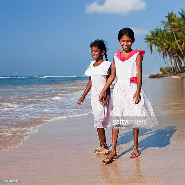 two sri lankan young girls on the beach - sri lankan culture stock pictures, royalty-free photos & images