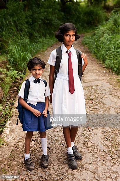 two sri lankan young schoolgirls on way to school - sri lankan school girls stock photos and pictures