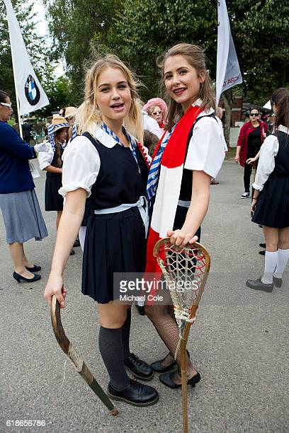 Two St Trinians Schoolgirls holding netball and hockey stick at Goodwood on September 9 2016 in Chichester England