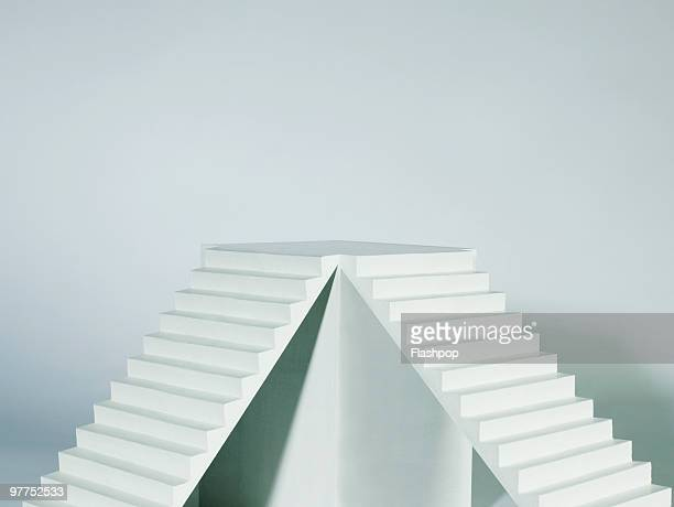 two stairways joined together - stairs stock photos and pictures