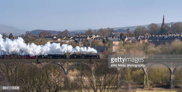 Two steam trains cross New Mills viaduct in Derbyshire