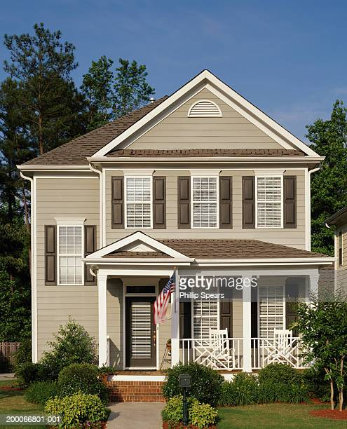 two story home with american flag - middle class stock pictures, royalty-free photos & images