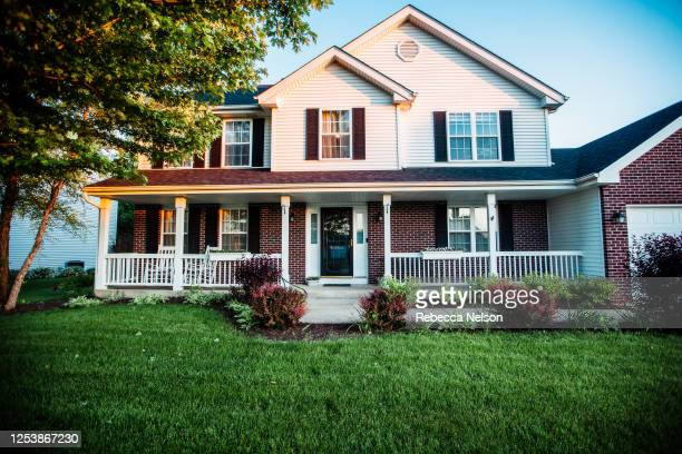 two story home with front porch - ポーチ ストックフォトと画像