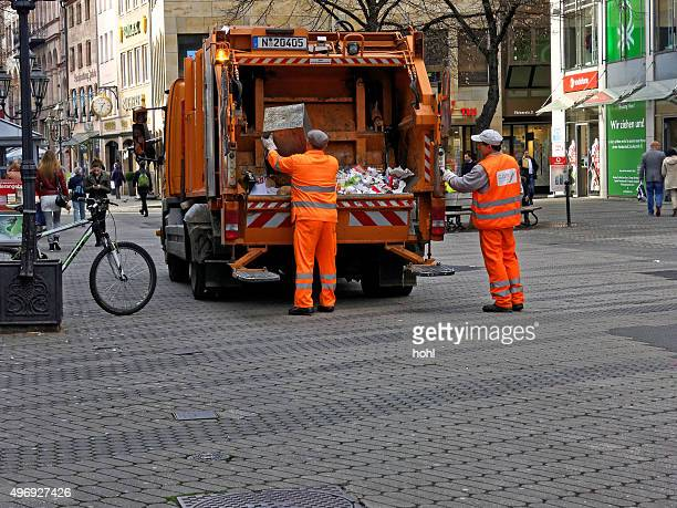 two street cleaners at work - garbage truck stock pictures, royalty-free photos & images