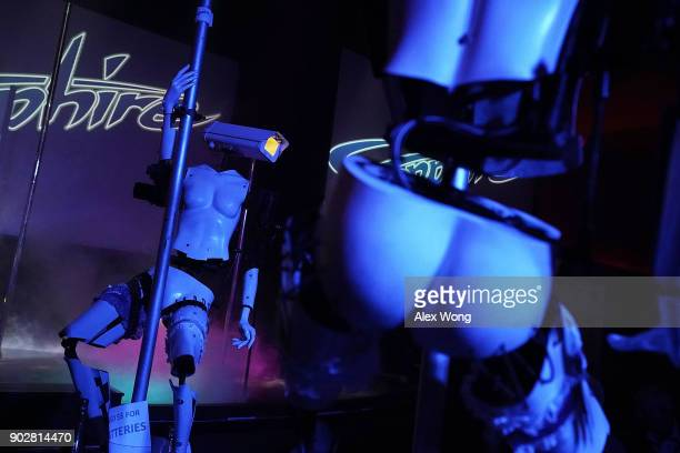 Two 'stripper robots' perform during a debut of the first robotic erotic dancers in the world at Sapphire Las Vegas Gentlemen's Club on the eve of...