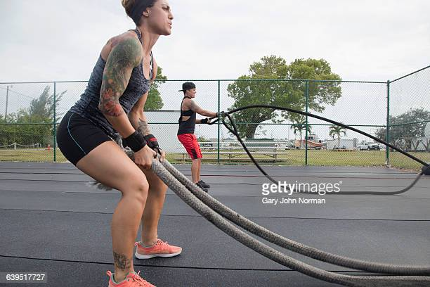 Two strong woman working out at gym outdoors.