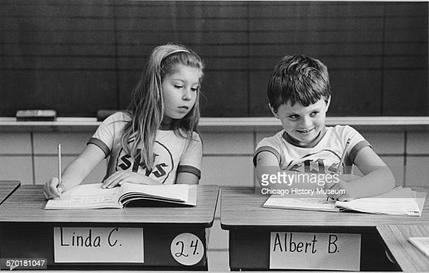 Two students Albert B and Linda C doing classwork at St Hyacinth's Catholic Elementary School Chicago Illinois December 1987