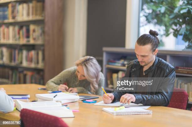 two students diligently study in university library - master's degree stock pictures, royalty-free photos & images