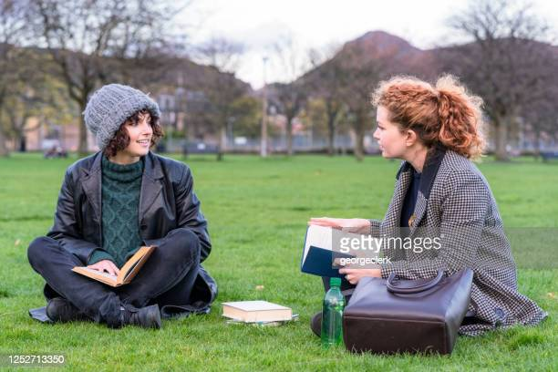 two students discussing their studies - winter stock pictures, royalty-free photos & images