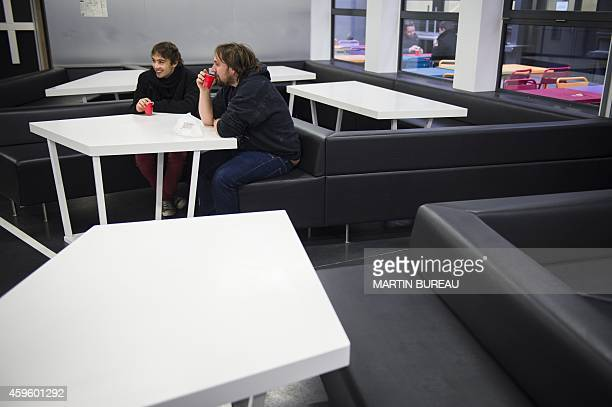 Two students drink coffee at the 42 school campus in Paris on November 24 2014 Known simply as 42 the private computer programming school was created...