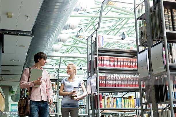 Two students in a university library