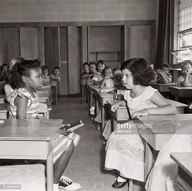 Two students in Fort Myer Elementary School face each other on the first day of desegregation The school operated by the military for the children of...