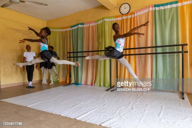 Two students practice a dance routine during rehearsals at the Leap of Dance Academy in Ajangbadi, Lagos, on July 3, 2020. - The Leap of Dance...