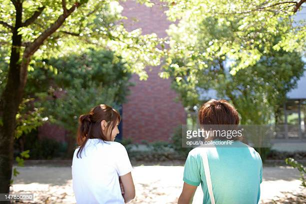 Two students sitting outside