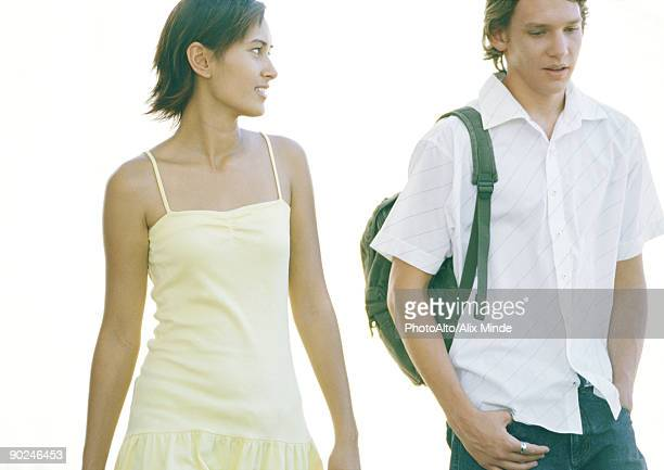 two students walking side by side - strap stock pictures, royalty-free photos & images