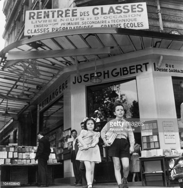 Two students with their arms full of books leaving the book shop GIBERT JOSEPH's in Paris The backtoschool ritual regularly brings in a crowd of...