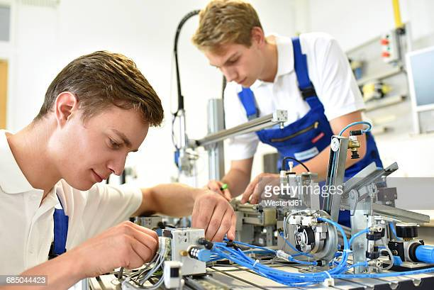 two students working with pneumatics component parts - mechatronics stock pictures, royalty-free photos & images