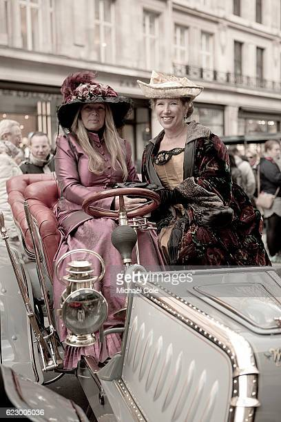 Two stylish ladies in period costumes hats sitting in a 1902 Westfield in The International Concours D'Elegance at Regent Street on November 5 2016...