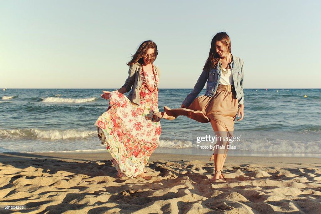 Two stylish women on the beach : Stock Photo