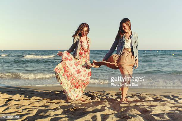 two stylish women on the beach - long dress stock pictures, royalty-free photos & images