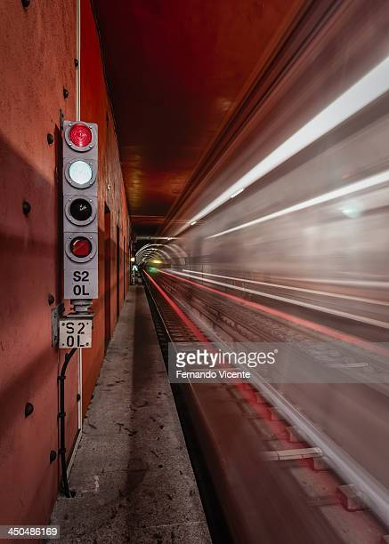 CONTENT] two subway trains crossing at the same time leaving its light trails to paint the scenery