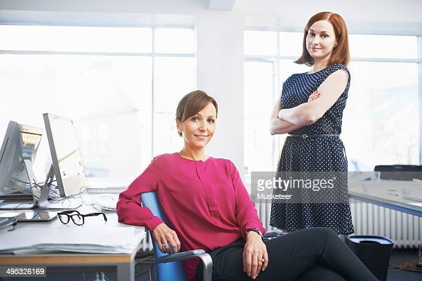 Two successful women in bright office