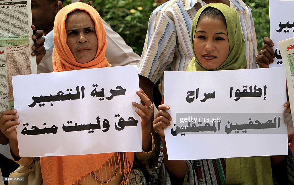 Two Sudanese women hold up placards that read, 'Freedom of expression is a right and not granted' (L) and ' Free jailed journalists' as they protest against the storming by security forces of two newspapers in the capital Khartoum on May 20, 2010. Sudanese security officers stormed two newspapers yesterday tearing up articles ready for printing, employees said, despite a 2009 presidential decree promising to lift press censorship. Authorities went to the offices of the Ajras al-Hurriya, which is linked to the former southern rebel Sudan People's Liberation Movement and the independent daily Al-Sahafa, and confiscated articles. Sudan boasts around 30 titles in both English and Arabic published daily to represent all persuasions -- pro-government, Islamist or communist -- and showcase the country's multi-faceted political make-up.