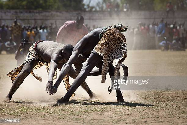 Two Sudanese wrestlers fight at a stadium in the southern Sudanese city of Juba during the final of Sudan's first commercial wrestling league between...