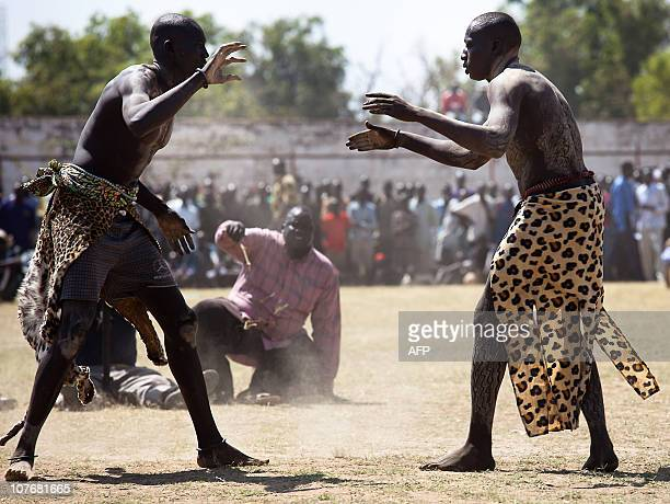 Two Sudanese wrestlers prepare to fight at a stadium in the southern Sudanese city of Juba during the final of Sudan's first commercial wrestling...
