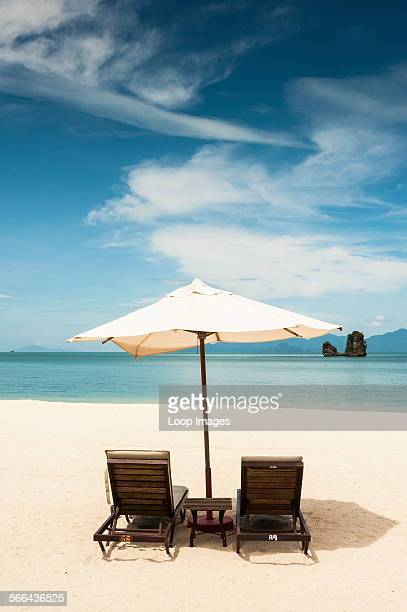 Two sunloungers and an umbrella on Tanjung Rhu beach in Langkawi