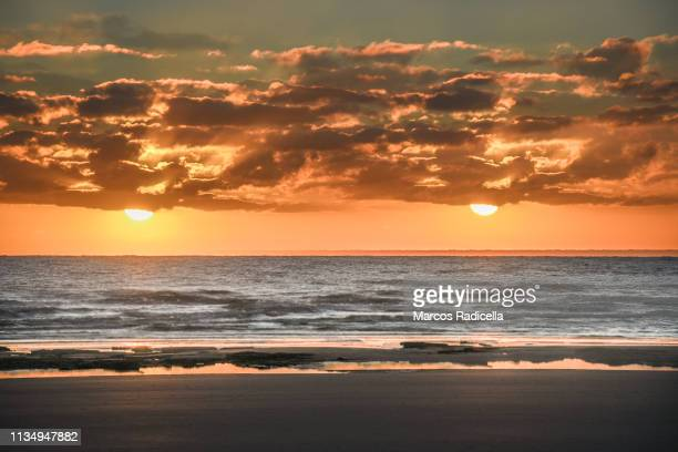 two suns in the sunrise - radicella stock pictures, royalty-free photos & images