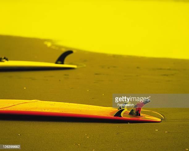two surfboards laid on beach, shonan, kanagawa prefecture, japan, high angle view, toned image - kanto region - fotografias e filmes do acervo