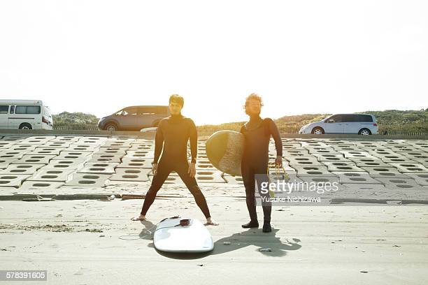 Two surfers looking at the sea