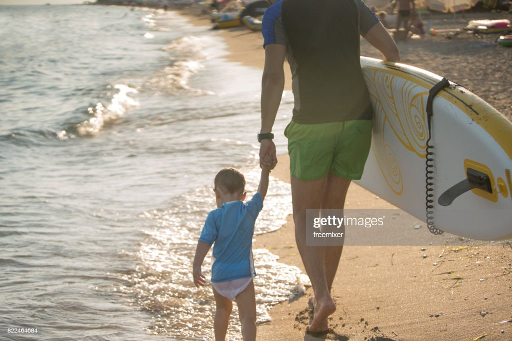 Two surfers on the beach : Stock Photo