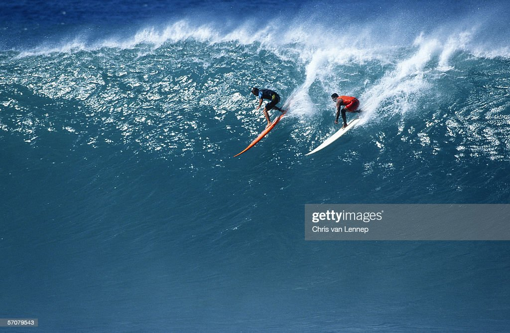 Two Surfers Riding a Huge Wave : Stock Photo