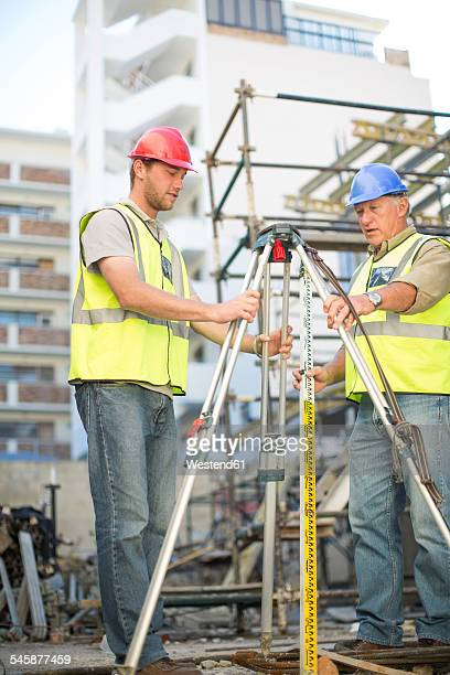 Two surveyors on construction site