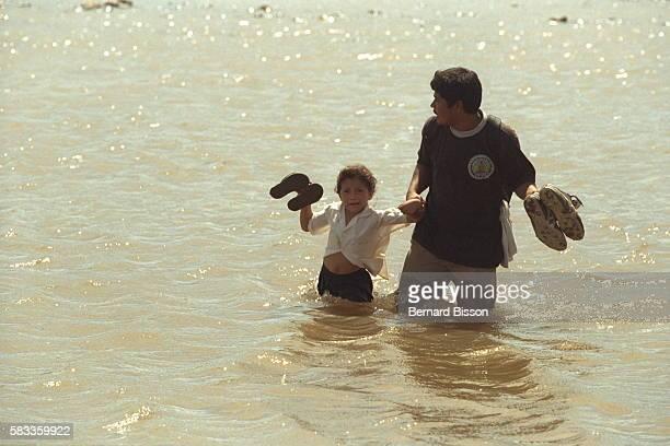 Two survivors cross the Choluteca river